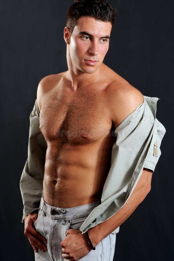 musculous manlig fotografering för bildbyråer