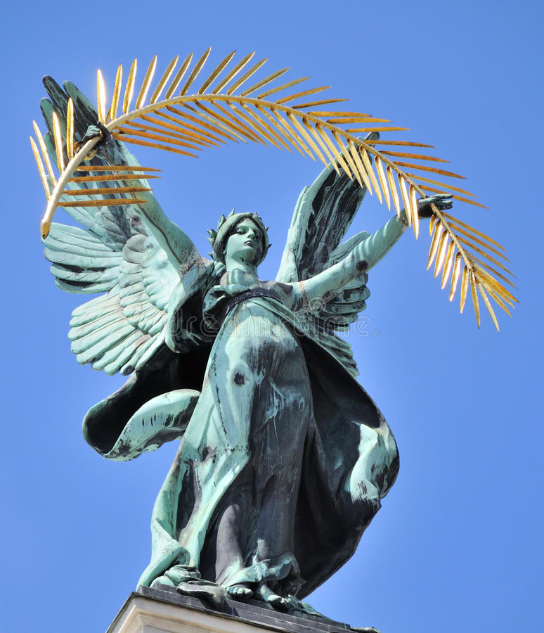 Muse with a harp on the roof of theater. Lvov, Ukraine royalty free stock photo