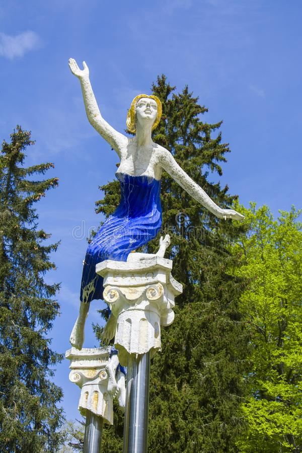 Muse statue by the Forest spring - park in the small west Bohemian spa town Marianske Lazne Marienbad - Czech Republic. Work of the famous sculptor Olbram stock photos