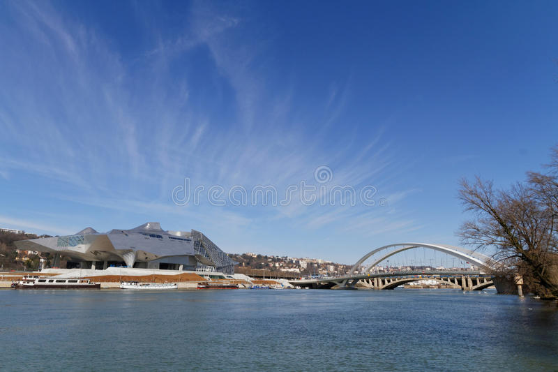 Musee des Confluences and Raymond Barre Bridge over Rhone river. LYON, FRANCE, February 28, 2015 : Musee des Confluences is a science and anthropology museum royalty free stock photos
