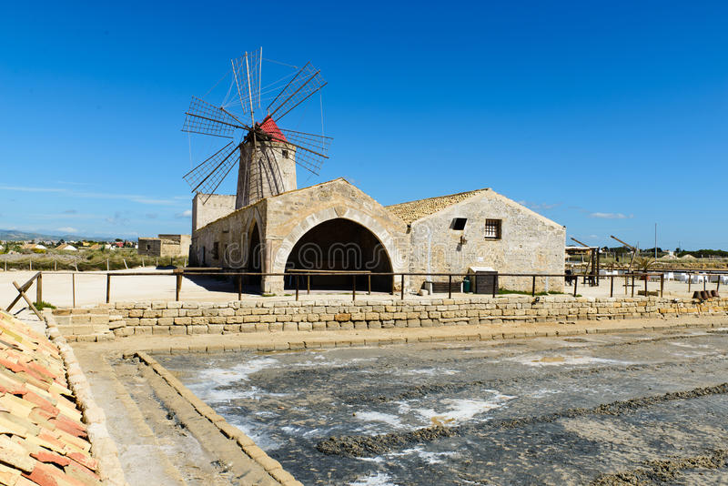Museo del Sale with a windmill royalty free stock photography