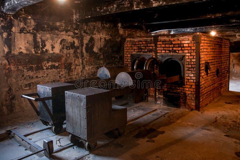 Museu do crematório do holocausto ao lado da câmara de gás Lugar escuro terrível em um campo de concentração imagens de stock royalty free