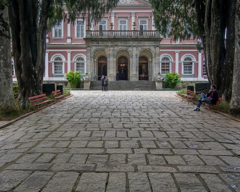 Museu Imperial de Petrópolis front entrance. Petropolis, Rio de Janeiro, Brazil- May 17, 2018: People converse and relax in front of the entrance of Imperial stock image