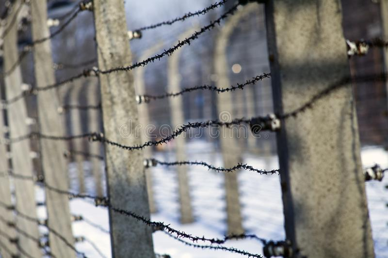 Museum Auschwitz - Holocaust Memorial Museum. Anniversary Concentration Camp Liberation Barbed wire around a concentration camp. stock photo