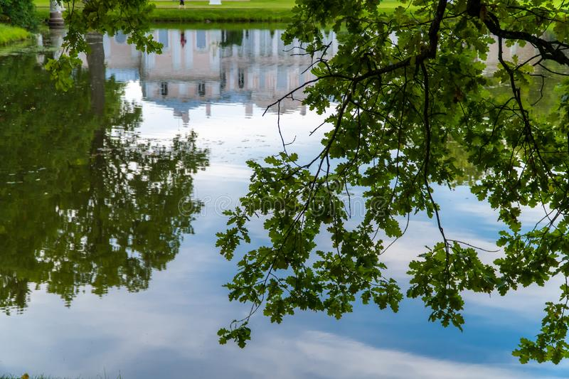 Museum of the Chinese Palace and the Chinese pond in the summer. Russia. Lomonosov. Museum of the Chinese Palace and the Chinese pond in the summer royalty free stock images