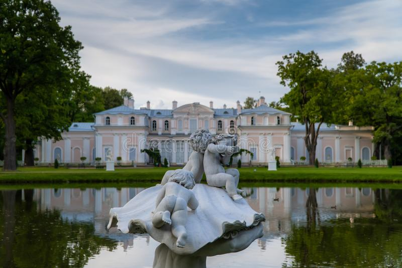 Museum Chinese Palace, a sculpture of a Triton in a Chinese pond in the summer. Russia. Lomonosov. Museum Chinese Palace, a sculpture of a Triton in a Chinese stock photo