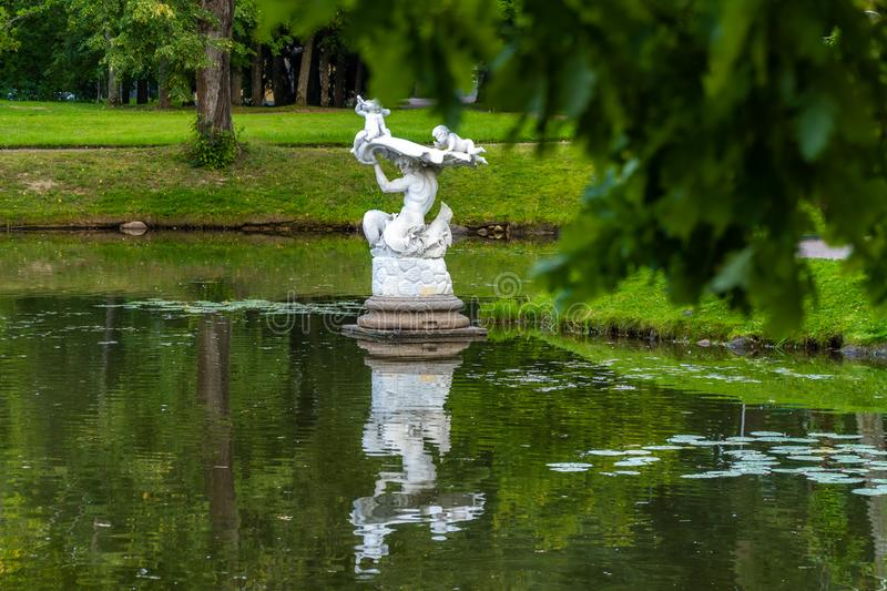 Museum Chinese Palace, a sculpture of a Triton in a Chinese pond in the summer. Russia. Lomonosov. Museum Chinese Palace, a sculpture of a Triton in a Chinese royalty free stock image