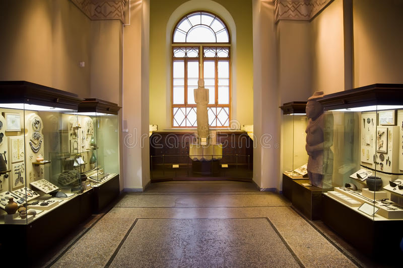 Museum Exhibits Of Ancient Relics In Glass Cases Stock Image
