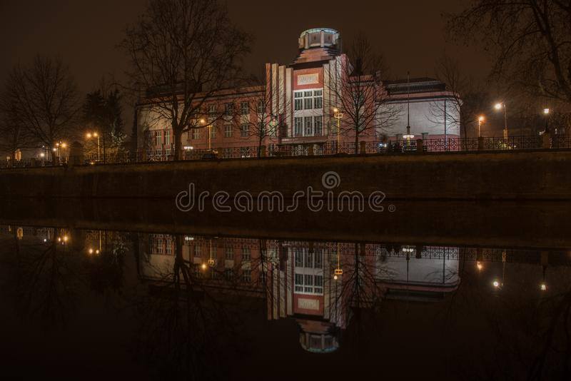 Museum in Hradec Kralove. And its reflection in river Labe seeing during night in winter royalty free stock photography