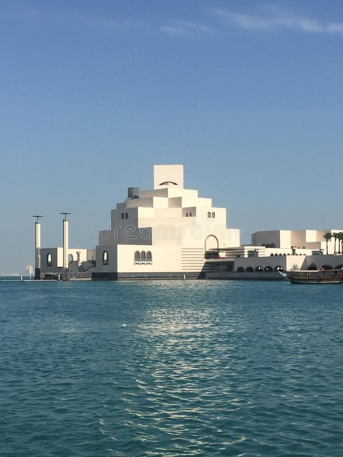 Museum of Islamic Art viewed across sea. The Museum of Islamic Art building, designed by architect I. M. Pei, with the sea in the foreground, located in Doha stock images
