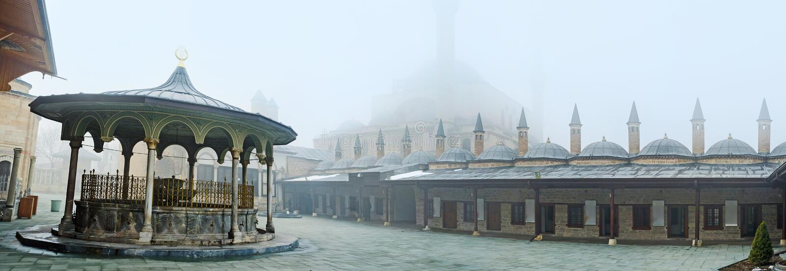The Museum of Mevlevi order. KONYA, TURKEY - JANUARY 20, 2015: The courtyard of Mevlana Museum with the view on the living chambers of dervishs and the stock photo