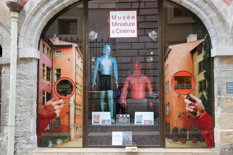 Museum of miniatures in french city Lyon in France. Glass showcase of the museum with a super heroes. royalty free stock photography