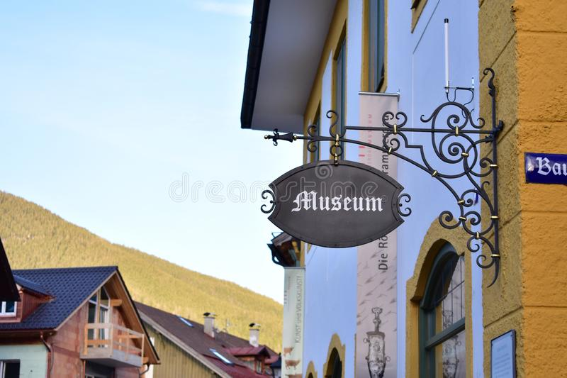 Museum sign in bavaria. Museum sign in Oberammergau with mountains in the backround stock photos