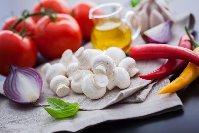 Mushroom champignon with italian ingredients stock photos