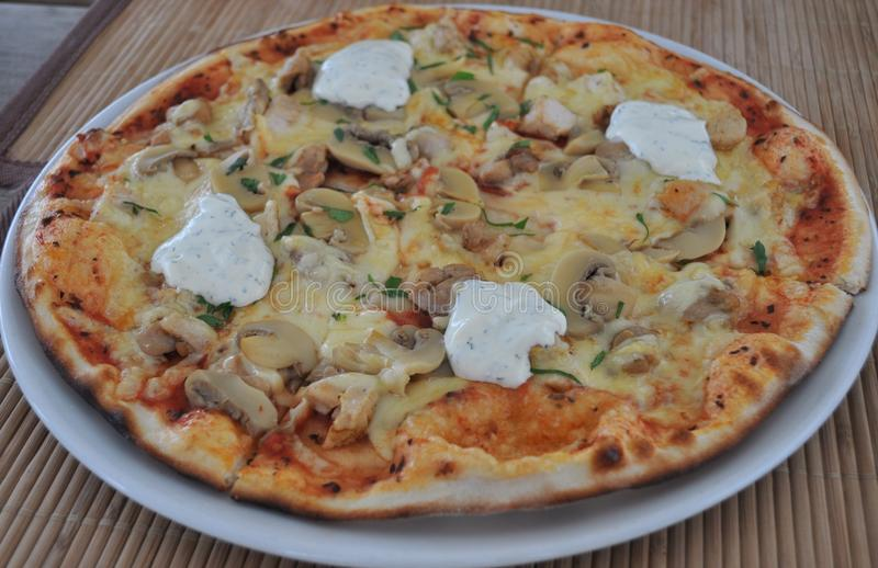 Mushroom and Chicken Pizza stock photos