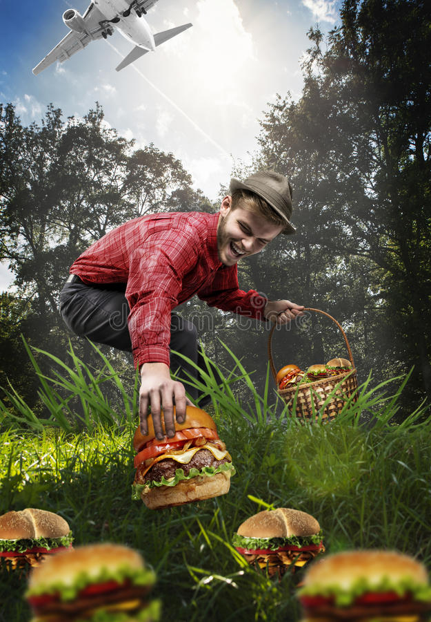 Mushroom collector collects only hamburgers. Abstract image of a mushroom collector collects only hamburgers stock photography