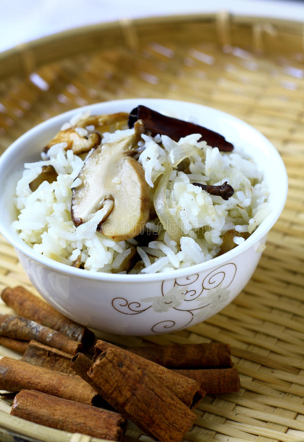 Mushroom Fried Rice. A vegetarian dish, fragrance fried rice with mushroom and cinnamon royalty free stock images