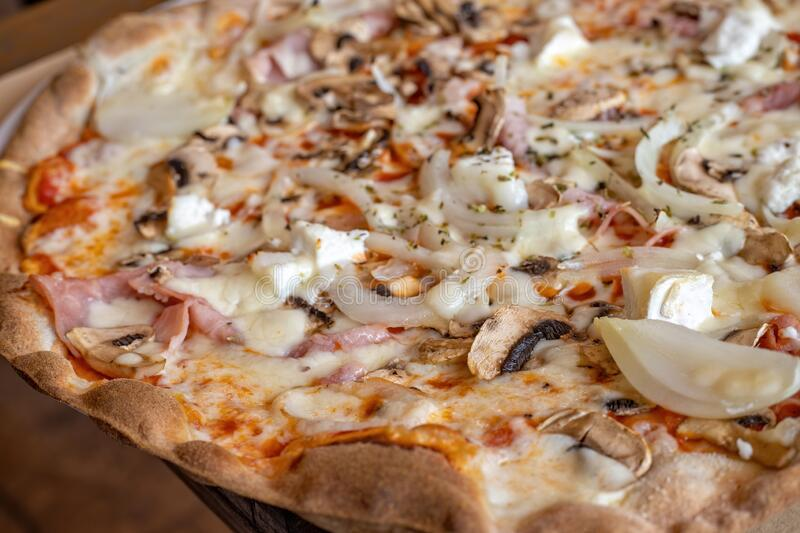 Mushroom and ham pizza on the table in the restaurant.  stock photo