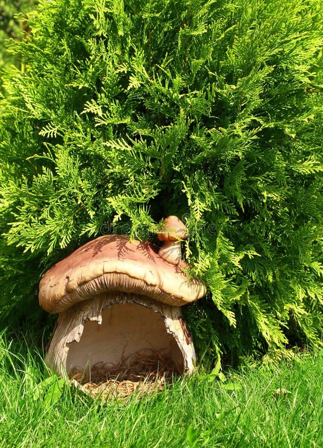 Mushroom - house. Fantastic mushroom - house in a green grass royalty free stock photo