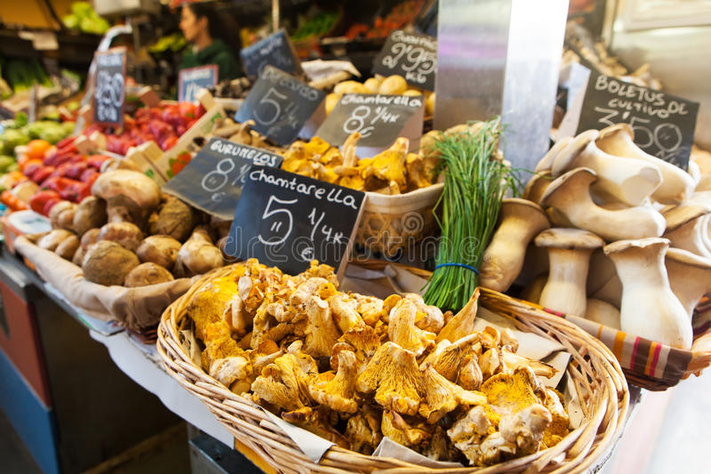 Mushroom market in Spain, with chantarellus in the foreground. stock image