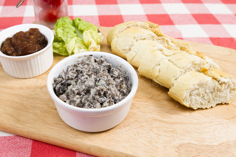 Mushroom pate with French baguette. Mushroom pate with relish lettuce and tomatoes royalty free stock photography