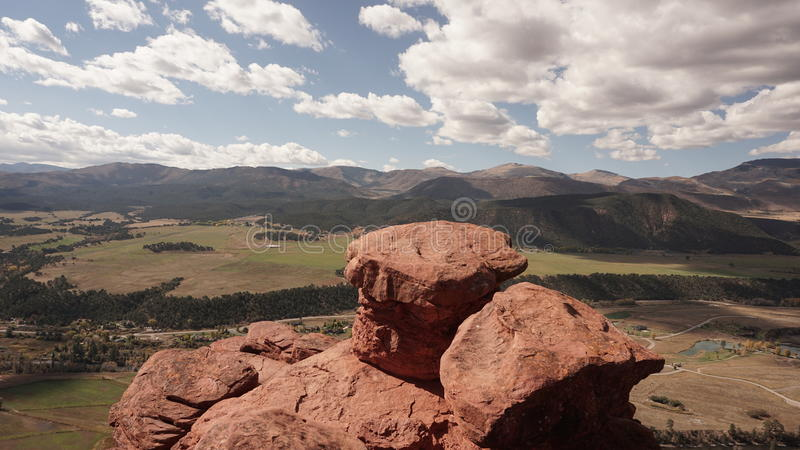 Mushroom rock in Carbondale Colorado. Mushroom rock overlooking Carbondale Colorado with the mountains and the Plains in the background royalty free stock image