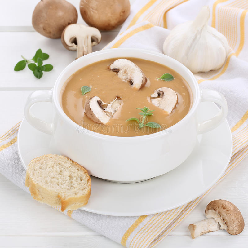 Mushroom soup with mushrooms in bowl healthy eating. Mushroom soup meal with fresh mushrooms in bowl healthy eating royalty free stock photography