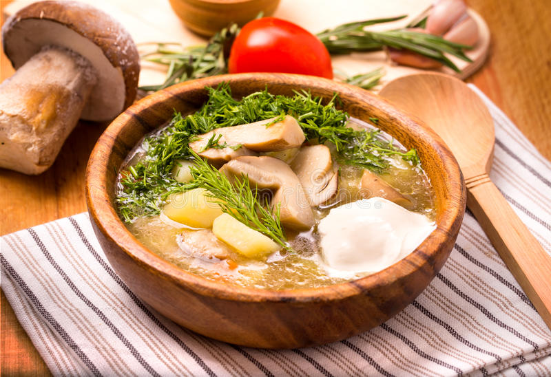 Mushroom vegetable soup. In a wooden bowl closeup royalty free stock photos