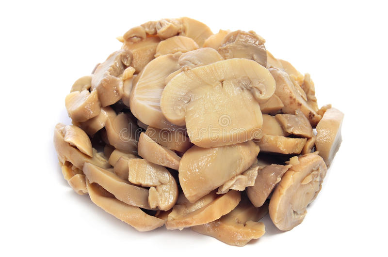 Mushrooms. Cooked sliced mushrooms on a white background royalty free stock photos