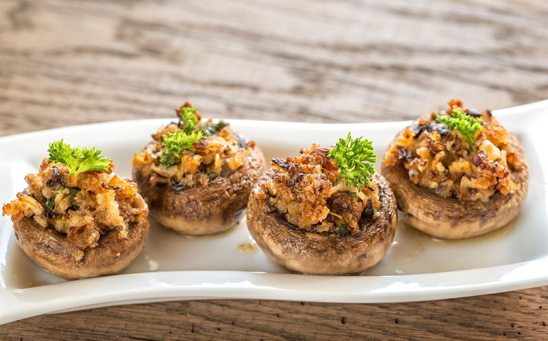 Mushrooms' caps stuffed with cheese, onion, breadcrum royalty free stock photos