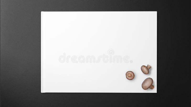 Mushrooms on the paper on the black background royalty free stock photo