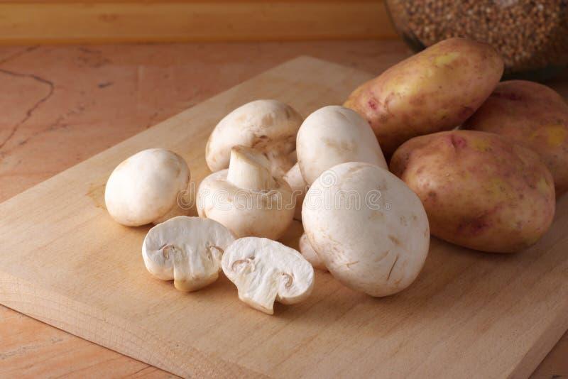 Mushrooms and potatoes stock photography