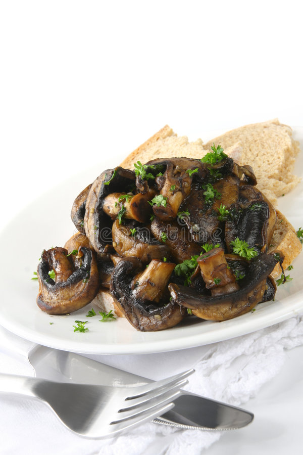 Mushrooms on Toast. Grilled field mushrooms with rye bread toast, garnished with parsley stock photos