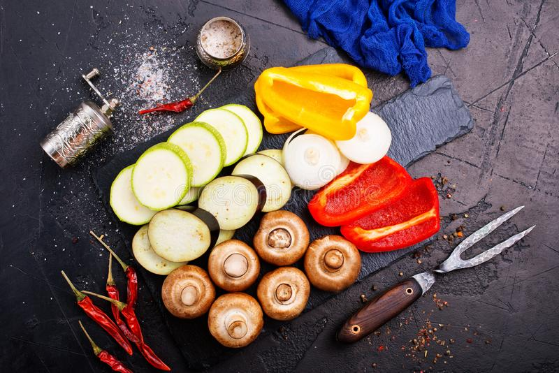 Mushrooms with vegetables on board. Vegan food on board, mushrooms with vegetables stock photos
