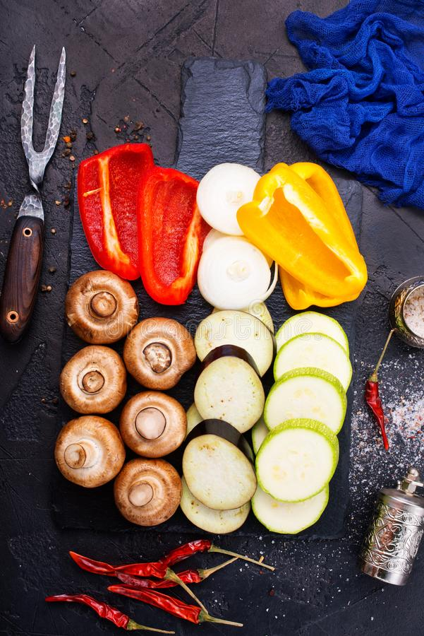 Mushrooms with vegetables on board. Vegan food on board, mushrooms with vegetables stock images