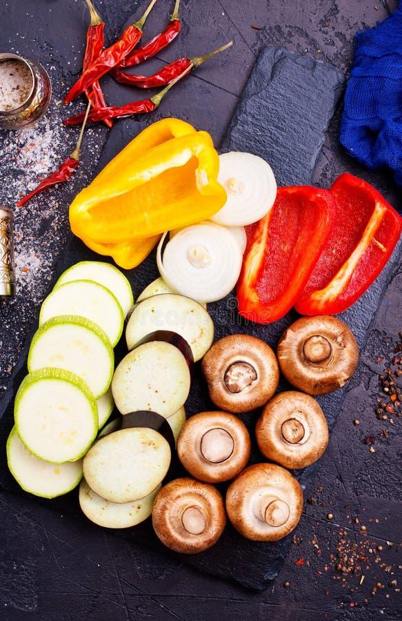 Mushrooms with vegetables on board. Vegan food on board, mushrooms with vegetables royalty free stock photos