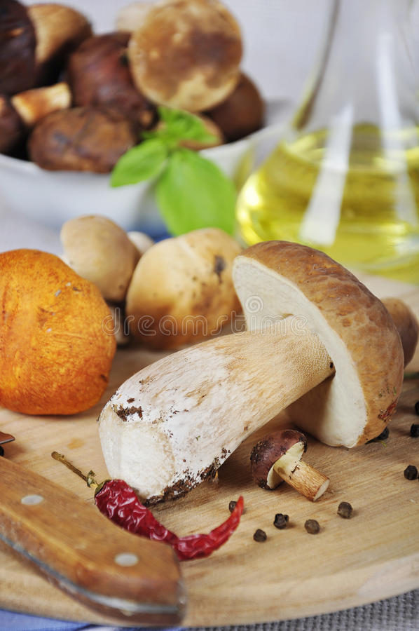 Download Mushrooms On Wooden Cutting Board Royalty Free Stock Image - Image: 26636256