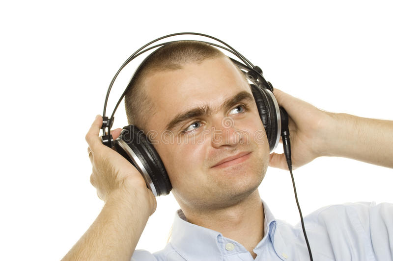 Music. Young man listening music. On a white background royalty free stock photo