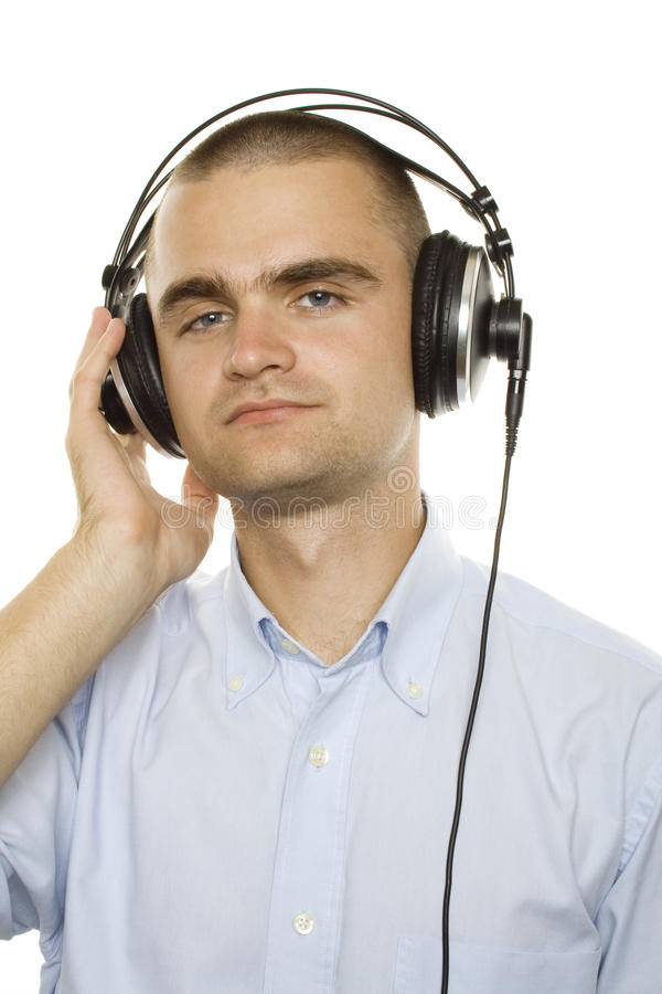 Music. Young man listening music. On a white background royalty free stock image