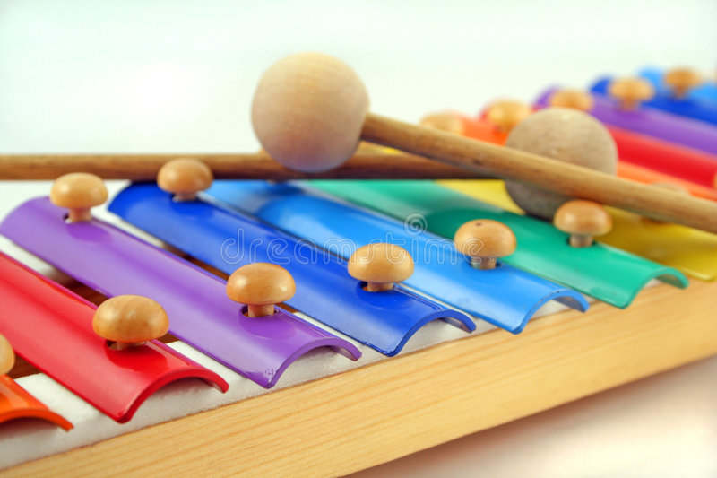 Music 2. Colourful child's glockenspiel with two crossed mallets stock photo