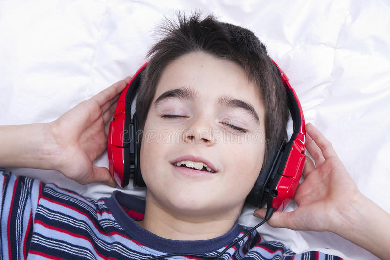 Music. Preteen boy listening music in the room royalty free stock images