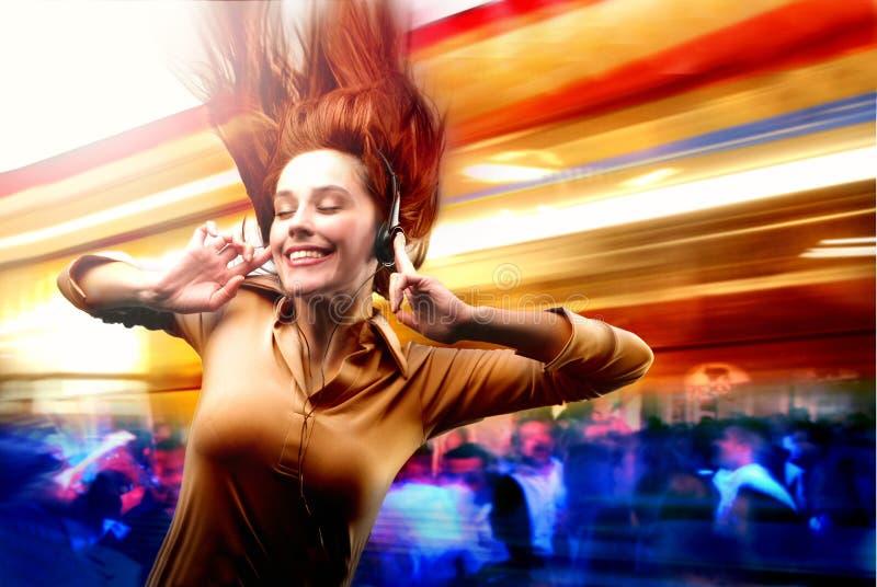 Music. A girl dance with a ear-phones
