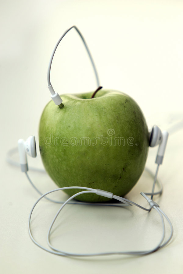 Music apple. Headphones wire turn in to music apple royalty free stock photos