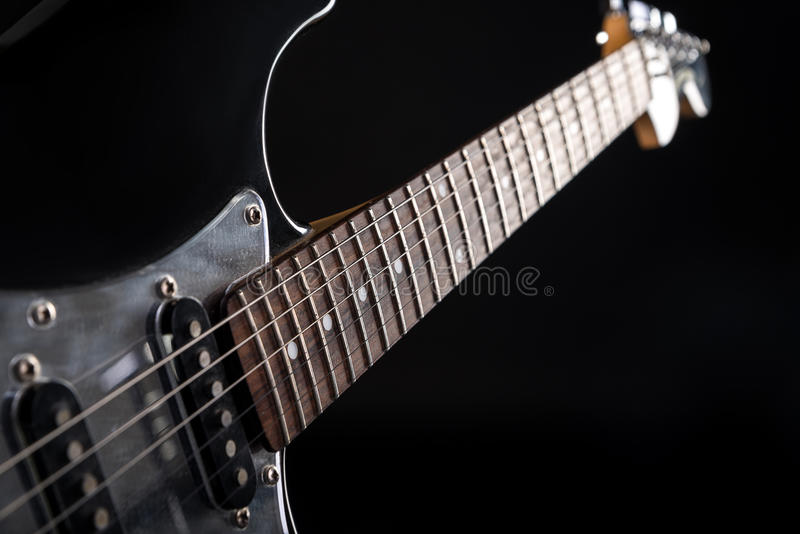 Music and art. Electric guitar on a black isolated background. Horizontal frame. Music and art. Electric guitar on a black isolated background stock images