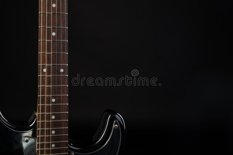 Music and art. Electric guitar on a black isolated background. Horizontal frame. Music and art. Electric guitar on a black isolated background stock photos