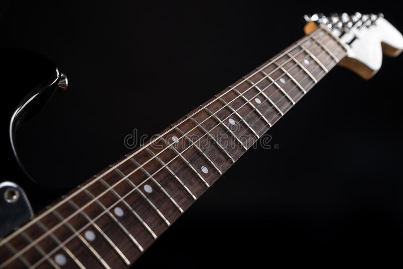Music and art. Electric guitar on a black isolated background. Horizontal frame. Music and art. Electric guitar on a black isolated background royalty free stock photography