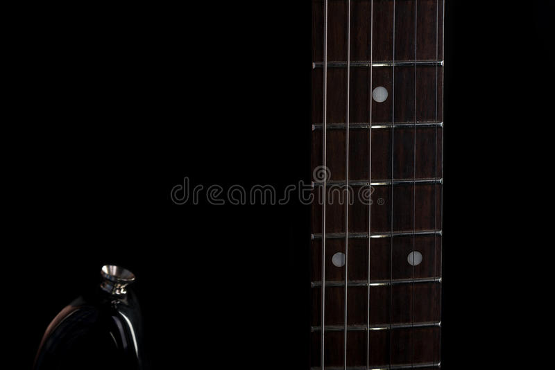 Music and art. Electric guitar on a black isolated background. Horizontal frame. Music and art. Electric guitar on a black isolated background royalty free stock images