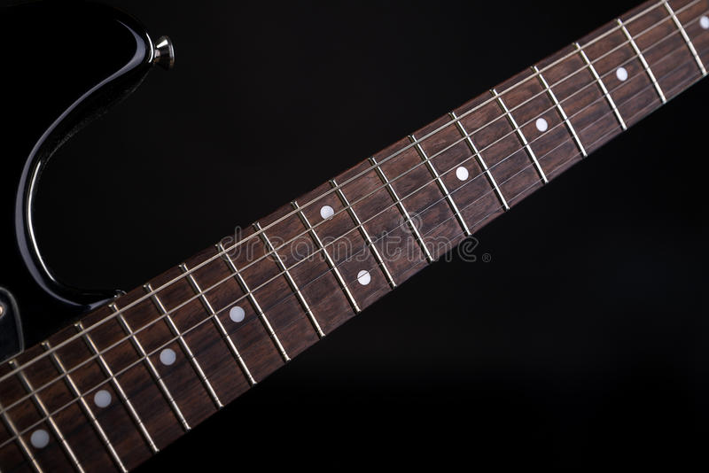 Music and art. Electric guitar on a black isolated background. Horizontal frame. Music and art. Electric guitar on a black isolated background stock photography