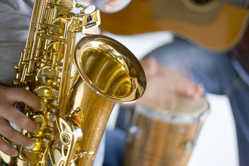 Music band. Close-up of a music band. Focus on the saxophone in the foreground stock image