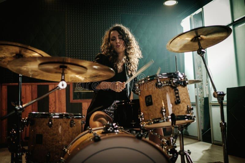 Music band having rehearsal. In garage studio stock photos
